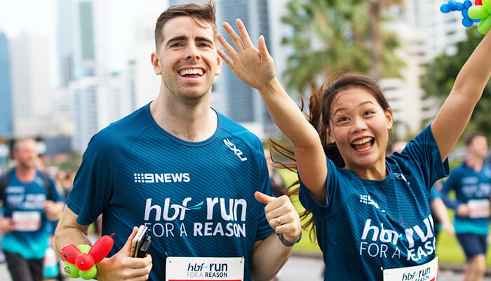 Man and woman running in the HBF Run for a Reason 4km