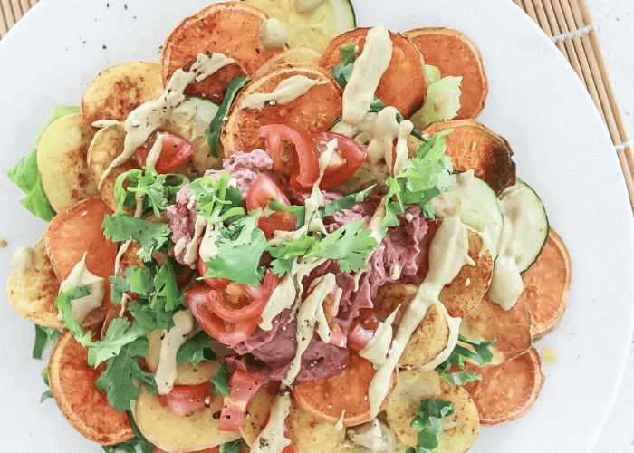A plate of potato and spicy refried bean nachos